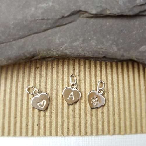 hand stamped sterling silver heart initial charm