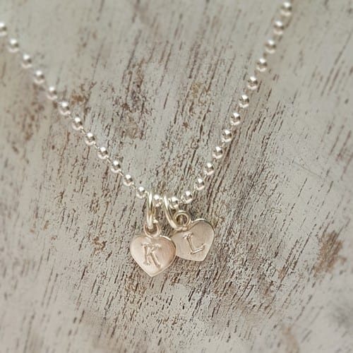 hand stamped sterling silver initial charm