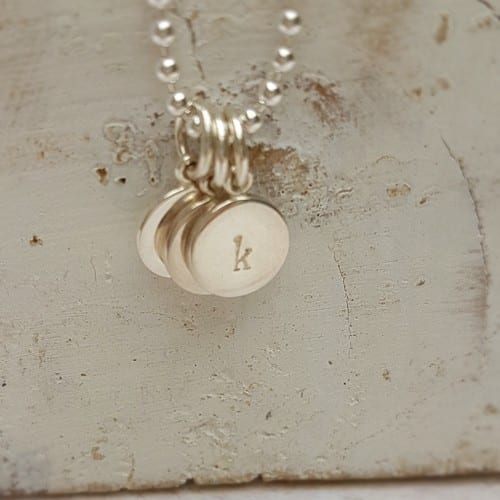 hand stamped personalised initial charm sterling silver