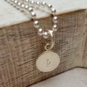 hand stamped sterling silver 9mm round initial charm