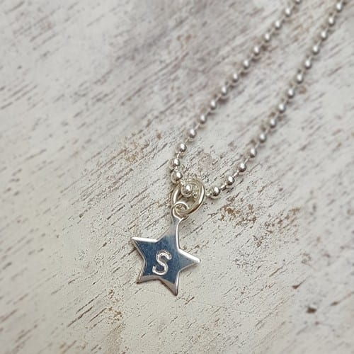 hand stamped sterling silver star charm