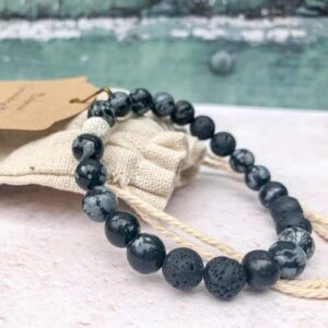 snowflake obsidian essential oil bracelet with lava beads and a sterling silver bead
