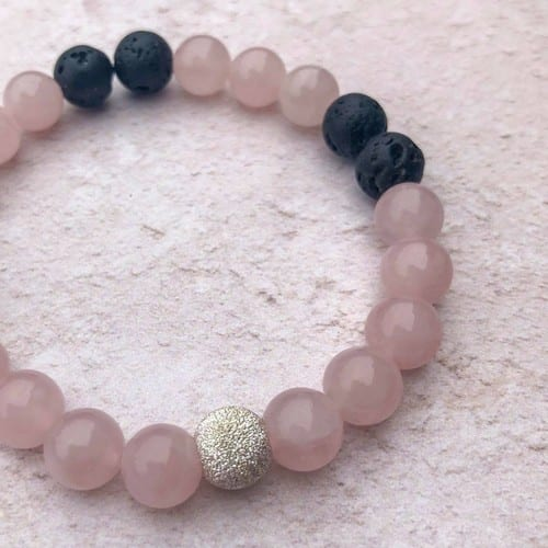 rose quartz essential oil bracelet with lava beads and a sterling silver bead